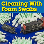 Cleaning model trains with foam tipped swabs